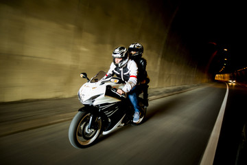 Young man and a woman on a motorcycle