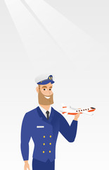 Young caucasian airline pilot holding the model of airplane in hand. Cheerful hipster airline pilot in uniform. Smiling pilot with the model of airplane. Vector cartoon illustration. Vertical layout.