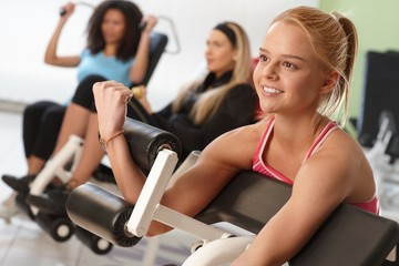 Exercising on weight machine