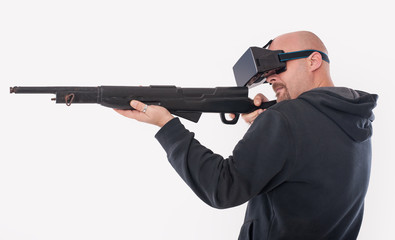 Man play VR shooter game with vr rifle and glasses