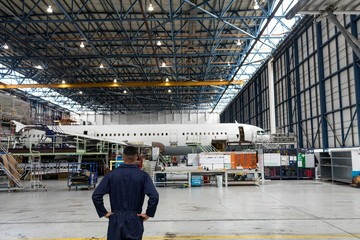 Aircraft maintenance engineer standing at airlines maintenance