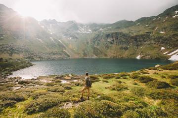 Man tourist looking at lake
