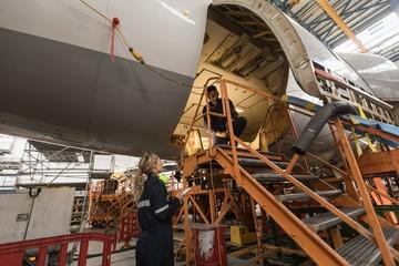 Aircraft maintenance engineers working over an aircraft