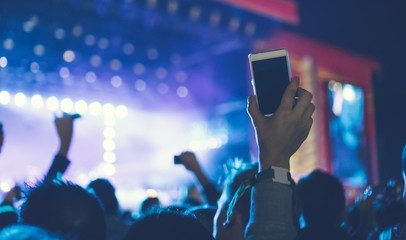 white smartphone in the air on festival
