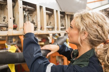 Female aircraft maintenance engineer working over an aircraft