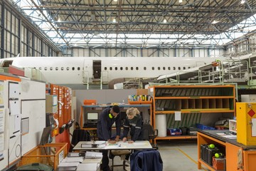 Aircraft maintenance interacting with each other