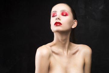 girl with the red eyeshadow covered with gloss