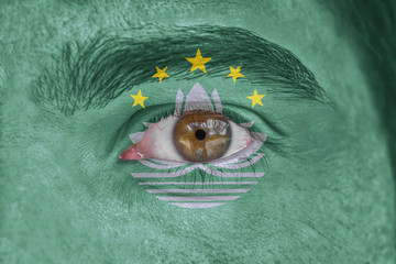 Human face and eye painted with flag of Macau