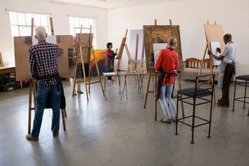 Senior people painting in art studio