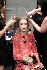 A model gets her hair and makeup done backstage at the John Paul Ataker Spring Summer 2018 collection show during New York Fashion Week in the Manhattan borough of New York City