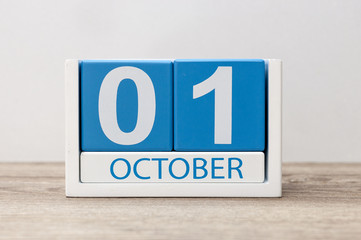 October 1st . October 1 white and blue wooden calendar on light wood abstract background. Autumn day