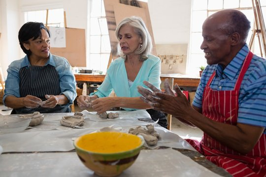 Senior man and women making clay products