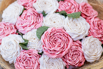 A bouquet of artificial white and pink roses