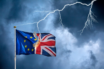 Concept of the British Brexit with the English flag struck by lightning