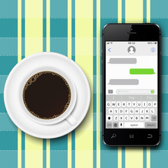 Chating and messaging concept. Smartphone with sms chat on screen and coffee cup on the tablecloth.