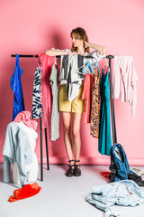 Woman standing in her pink wardrobe