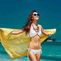 Beautiful girl enjoying freedom on the beach