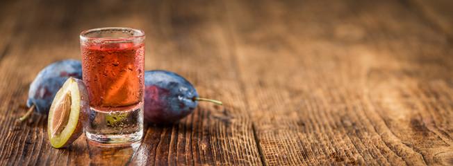 Portion of Plum Liqueur, selective focus