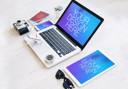 3 Devices with Passport and Travel Accessories Mockup 1