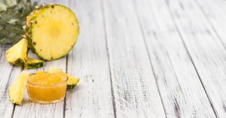Pineapple Jam on vintage wooden background