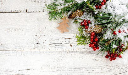Christmas decoration on white old wooden board