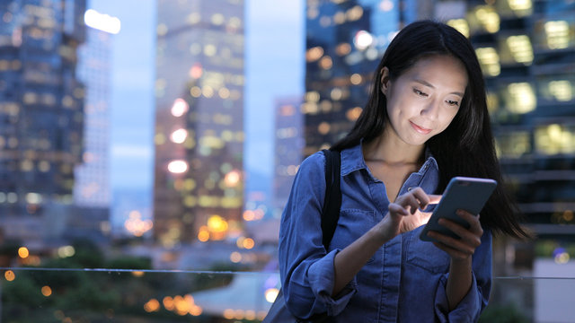 Asian Woman send text message on cellphone