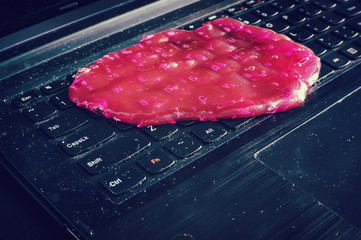 Keyboard cleaning gel is laying on the notebook.