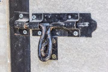 Black metal latch door bolt.