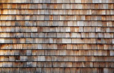 Grunge cedar tile panel on the exterior wall
