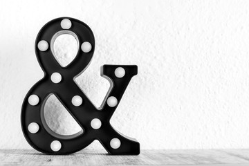 ampersand & sign with bulbs on a white background