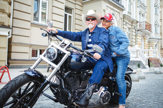 Mature man and woman on a motorcycle.