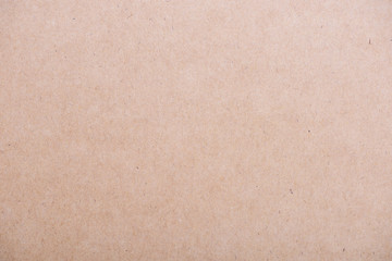 Brown textured cardboard background.