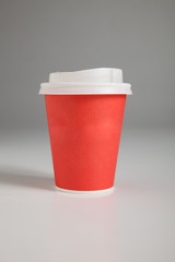 Paper cups on gray background