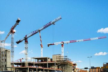 Construction with a cranes, a tower cranes on the construction of a building