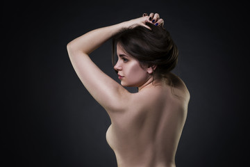 Art nude, naked body, sexy woman on black background