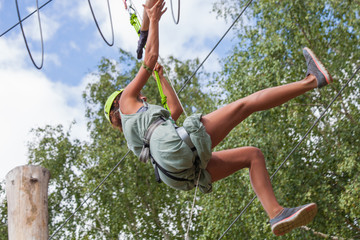 young woman in adventure park summer challenge