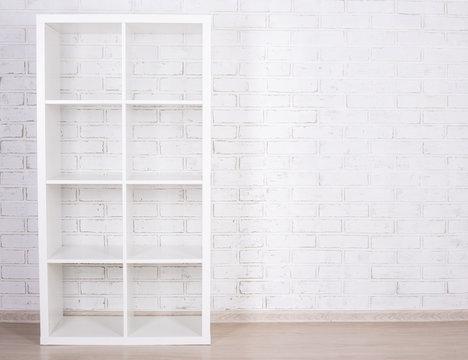 white wooden shelf over white wall