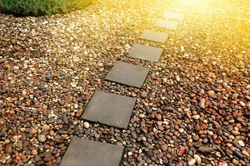 stone paving winding walkway in garden