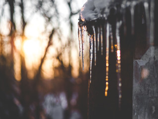 Beautiful Photo Winter, icicles hanging from the roof, sunset