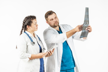 healthcare and medical concept, doctor and student looking at an x-ray.