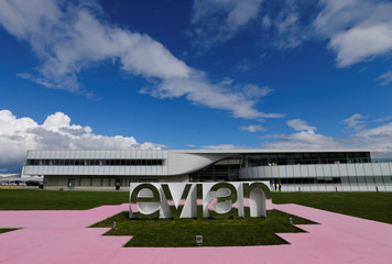 A logo is pictured outside the new Evian water bottling plant during the official opening ceremony in Publier
