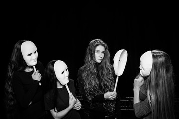 Theater of the mask. Girls and masks. A portrait of a theater actor.
