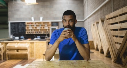 Portrait of young man having coffee in cafe