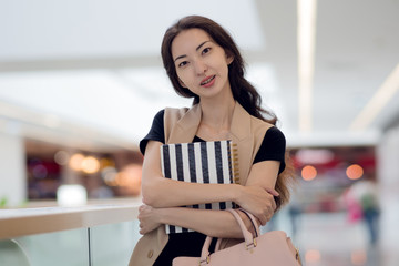 Beautiful girl with a diary in hand, the portrait in the lobby of shopping Mall or business center