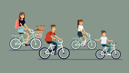 Active family vacation. Father mother, son and daughter are riding on bicycles in the park.