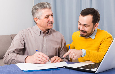 Man and sales manager discuss contract