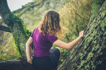 Woman climbing a tree