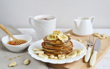 Homemade Banana Cashew Pancakes Honey Sauce Milk Flour Wooden Table Kitchen Towel Cutlery