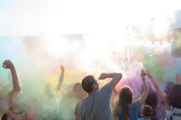 people covered with colored powder