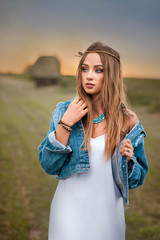 beautiful boho hippie girl with jeans jacket and white dress